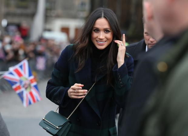 Meghan Markle smiles as she arrives to meet members of the public during a walkabout on the Esplanade at Edinburgh Castle, during a visit to Scotland on February 13, 2018. (Photo by Andrew Milligan / POOL / AFP)