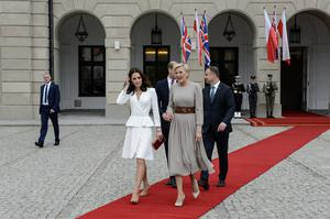 Catherine, Duchess of Cambridge (L) with the first Lady Agata Kornhauser-Duda (R) walk on the red carpet during an official visit by the Duke And Duchess Of Cambridge on July 17, 2017 in Warsaw, Poland. (Photo by Adam Nurkiewicz/Getty Images)