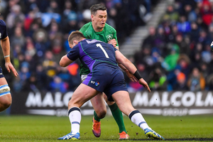 SMASH: Ireland's Jonathan Sexton is tackled by Scotland's Allan Dell after off-loading a pass at Murrayfield in Edinburgh last month. Photo by Brendan Moran/Sportsfile