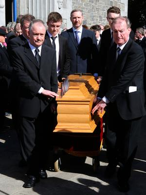 Sean, left and Ciaran Haughey, stand by as the coffin leaves St. Sylvester's Parish Church, Malahide after the funeral of his mother, Maureen Haughey. Credit: Damien Eagers