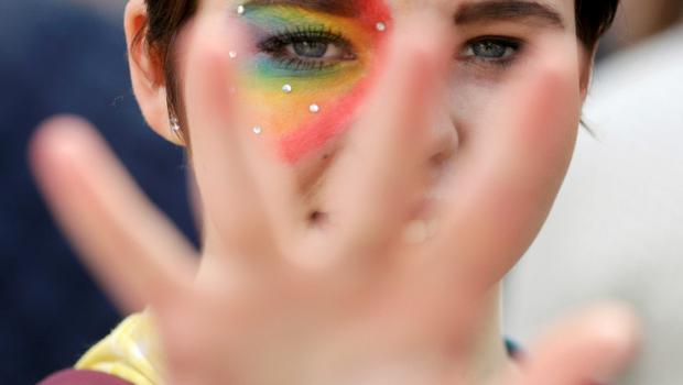 A woman with a rainbow painted takes part in the Rainbow Project rally for marriage equality in Belfast, Northern Ireland, June 13, 2015. REUTERS/Jason Cairnduff