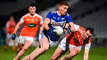 Laois' Evan O'Carroll in action against Brendan Donaghy of Armagh during the Allianz Football League Division 2 Round 2 match at MW Hire O'Moore Park in Portlaoise, Laois. Photo: Sam Barnes/Sportsfile