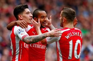 Theo Walcott celebrates with team mates after scoring the second goal for Arsenal Reuters / Eddie Keogh Livepic