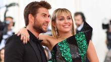 """Miley Cyrus (R) and Liam Hemsworth arrive for the 2019 Met Gala at the Metropolitan Museum of Art on May 6, 2019, in New York. - The Gala raises money for the Metropolitan Museum of Arts Costume Institute. The Gala's 2019 theme is Camp: Notes on Fashion"""" inspired by Susan Sontag's 1964 essay """"Notes on Camp"""". (Photo by ANGELA  WEISS / AFP)"""