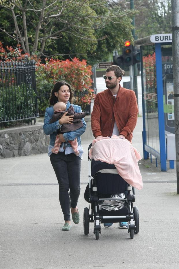 Jamie Dornan and his wife Amelia Warner with their baby