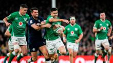 Conor Murray is tackled by Adam Hastings of Scotland