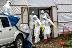 Members of the Ebola body management team remove dead bodies from a make shift morgue at Kenema General Hospital in Sierra Leone. Pic:Mark Condren