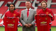 Manchester United manager Louis van Gaal (centre) with his new signings Radamel Falcao (left) and Daley Blind during a photocall at Old Trafford