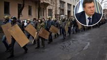 Protesters with shields and sticks move towards the parliament building in central Kiev, Ukraine, Saturday, Feb. 22, 2014. Ukraine's embattled president is calling the country's political crisis a coup and says it resembles the rise of Nazis in the 1930s. Viktor Yanukovych also says he has no intention of resigning or leaving the country. (AP Photo/Darko Bandic)