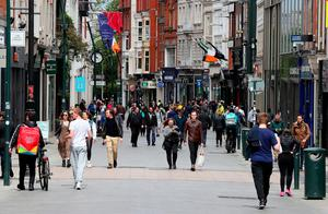 People on Dublin's Grafton street as restrictions put in place as a result of the coronavirus pandemic have been eased. Photo: Brian Lawless/PA Wire