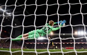Caoimhin Kelleher of Liverpool saves Dani Ceballos of Arsenal penalty during the penalty shoot out during the Carabao Cup match between Liverpool and Arsenal at Anfield. (Photo by Laurence Griffiths/Getty Images)
