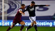 Burnley's Josh Benson (left) and Millwall's Troy Parrott battle for the ball