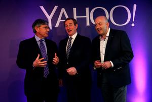 Taoiseach Enda Kenny (centre) with Ken Goldman CFO, Yahoo! (left) and Patrick Scully, MD of Yahoo EMEA operations, at the official opening of Yahoo EMEA's new offices in Dublin. Photo: Brian Lawless/PA Wire