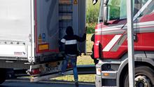 A migrant goes inside a lorry to attempt to cross the English Channel, in Calais, northern France. Photo: AP