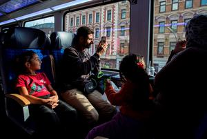 Ihab, 30, a Syrian migrant from Deir al-Zor, takes photographs from a train as he travels with his family from Hamburg to Lubeck, Germany, where his parent have taken refuge, September 18, 2015 file picture. REUTERS/Zohra Bensemra/Files