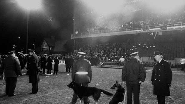Gardai patrol the pitch as supporters leave Lansdowne Road after rioting broke out in the Upper West Stand which resulted in the friendly between the Republic of Ireland and England being abandoned