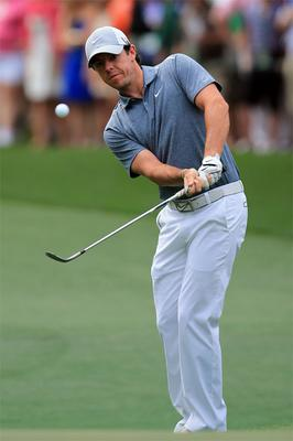Rory McIlroy hits a shot on the first hole