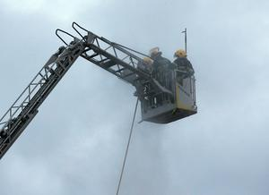 Firefighters in a hoist pictured at The Gloucester Place Fire this morning.