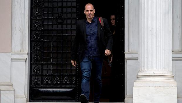 Greek Finance Minister Yanis Varoufakis leaves after a meeting at the office of Prime Minister Alexis Tsipras in Maximos Mansion in Athens, Greece June 28, 2015. Greece said it may impose capital controls and keep its banks shut on Monday after creditors refused to extend the country's bailout and savers queued to withdraw cash, taking Athens' standoff with the European Union and the International Monetary Fund to a dangerous new level. REUTERS/Marko Djurica