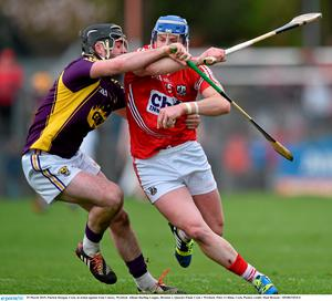 29 March 2015; Patrick Horgan, Cork, in action against Eoin Conroy, Wexford. Allianz Hurling League, Division 1, Quarter-Final, Cork v Wexford. P?irc U? Rinn, Cork. Picture credit: Matt Browne / SPORTSFILE