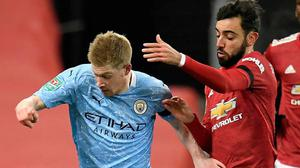 Contenders: Manchester City's Kevin De Bruyne (left) and Manchester United's Bruno Fernandes battle during the Carabao Cup semi-final match at Old Trafford