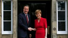 Scotland's First Minister Nicola Sturgeon (R), greets Britain's Prime Minister David Cameron, as he arrives for their meeting in Edinburgh, Scotland, Britain May 15, 2015. REUTERS/Russell Cheyne