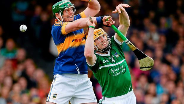 Tipperary's John O'Dwyer contests a dropping ball with Seamus Hickey