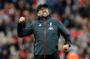 All or nothing: Klopp's pitch patrol is a feature of every fixture as he hunts each player in huggable distance. Photo: Phil Noble/Reuters