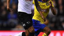 Cyrus Christie of Derby County battles with Nahki Wells of Huddersfield Town during the Sky Bet Championship match between Derby County and Huddersfield Town at iPro Stadium on November 4, 2014 in Derby, England.  (Photo by Laurence Griffiths/Getty Images)