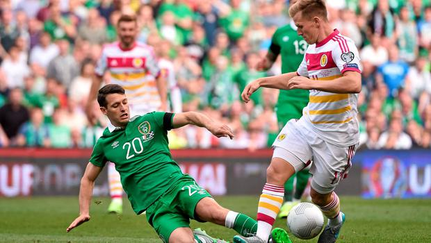 Ireland midfielder Wes Hoolahan makes a tackle on Scotland's Matt Ritchie. Photo: SPORTSFILE