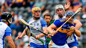 Jason Forde of Tipperary is tackled by Shane McNulty of Waterford