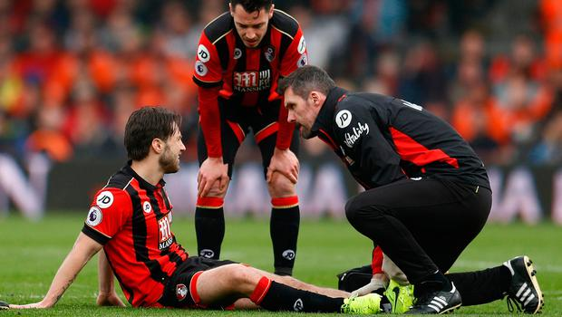 Harry Arter receiving treatment after shipping a knock during Bournemought's match against West Ham. Photo: Reuters / Peter Nicholls