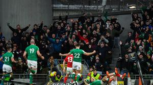 Ireland supporters celebrate as Andrew Conway of Ireland scores his side's fourth try during the Six Nations win over Wales at the Aviva Stadium. Photo by David Fitzgerald/Sportsfile