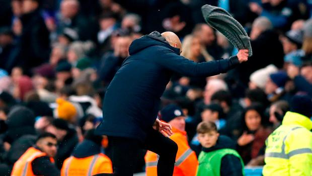 Scarf Ace: Pep Guardiola shows his frustration at the referee's failure to award a late free kick