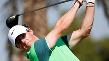 Rory McIlroy of Northern Ireland tees off on the third hole during the Dubai Desert Classic