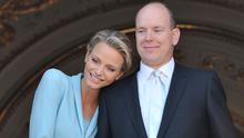 Princess Charlene of Monaco and Prince Albert II of Monaco pose on the balcony after the civil ceremony of the Royal Wedding