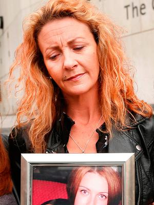 Lisa Finnegan with a portrait of her sister, Anna.  Picture; Gerry Mooney