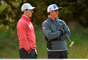 28 May 2015; Rory McIlroy and Rickie Fowler, right, in conversation during their round. Dubai Duty Free Irish Open Golf Championship 2015, Day 1. Royal County Down Golf Club, Co. Down. Picture credit: Ramsey Cardy / SPORTSFILE