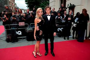Singer Pixie Lott and her boyfriend Oliver Cheshire arrive for the GQ Men of the Year Awards at the Royal Opera House