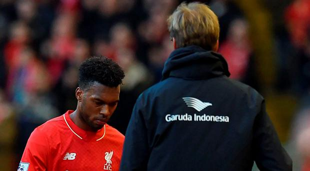Daniel Sturridge (L) as he is substituted by Liverpool manager Jurgen Klopp on Saturday