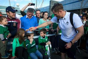 22/03/2015 Jamie Heaslip with Irish fans Michael Reehill 4 from Dublin & Aaron Redfern 6 from Limerick after the Irish Rugby side  arrived  at Dublin Airport following their 6 Nations Championship win  Photo:  Gareth Chaney Collins