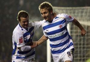 Kevin Doyle of Reading celebrates with team mate Noel Hunt after scoring during the Coca Cola Championship match between Reading and Watford at the Madejski Stadium on January 9, 2009 in Reading, England.  (Photo by Bryn Lennon/Getty Images)