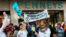 Message to shoppers: Extinction Rebellion protesters gather outside Penneys on O'Connell Street in Dublin Photo: Brian Lawless/PA