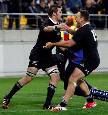 Richie McCaw (L) of New Zealand's All Blacks celebrates scoring a try with teammate Israel Dagg against South Africa's Springboks during their Rugby Championship match at Westpac Stadium in Wellington