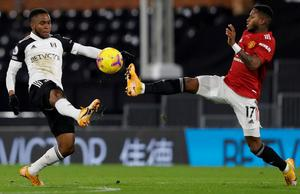Fulham goalscorer Ademola Lookman battles for possession with Fred of Manchester United at Craven Cottage. Photo: Getty Images