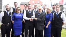 Alan Finn, the leader of the Shandrum Ceili Band presenting Gerry Murphy with a copy of the CD, the Boss Murphy Music Legacy at the launch of the CD at St. Mary's Church Buttevant, with the band members