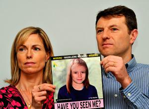 Gerry and Kate McCann hold an image of what Madeline might look like as an older girl Photo: John Stillwell/PA Wire