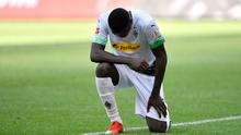 Borussia Moenchengladbach's Marcus Thuram kneels after celebrating their second goal in their Bundesliga win over Union Berlin on Sunday
