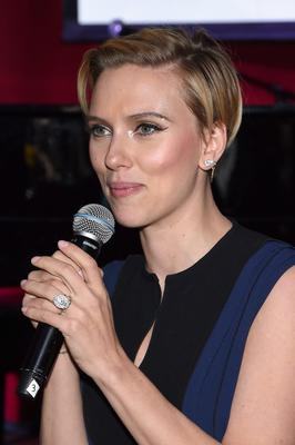 Actress Scarlett Johansson speaks onstage at the Friends Of Rockaway 2nd annual Hurricane Sandy fundraiser at Hudson Terrace on November 18, 2014 in New York City.  (Photo by Jamie McCarthy/Getty Images for Friends of Rockaway)