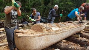 Logging on: Direct Provision volunteers in Kenmare, Co Kerry, help to recreate an ancient Irish dugout boat